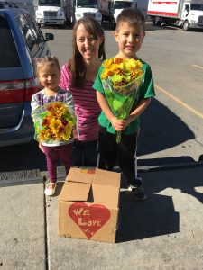 Kids Volunteering to Deliver Food Boxes